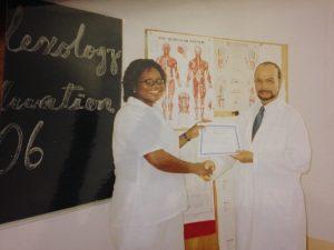 Prof Efrain Bernal Santiago with a past student of Reflexology
